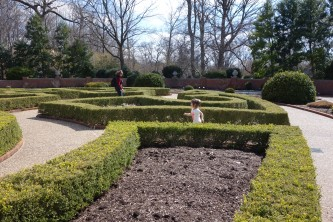 Charlotte chasing grandma in the Boxwood Garden
